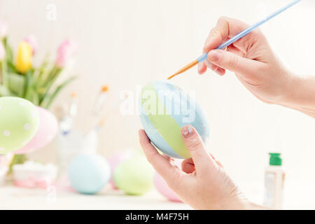 Pastel Easter egg handmade in a worshop. - Stock Photo
