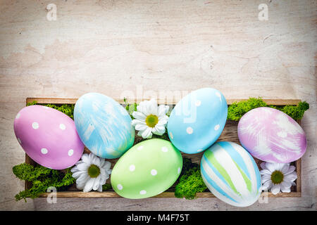 Easter decoration - eggs and flowers on a wood - Stock Photo