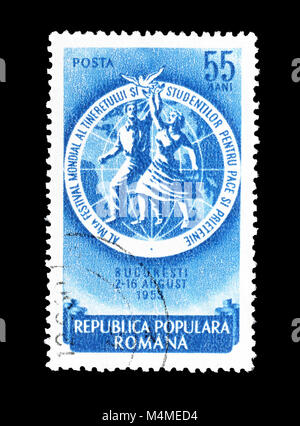 Cancelled postage stamp printed by Romania, that shows Girl and boy with peace dove in front of globe, circa 1953. - Stock Photo