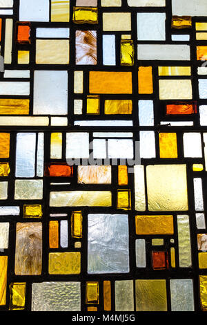 Modern Stained-glass window, abstract pattern, warm colours - Stock Photo