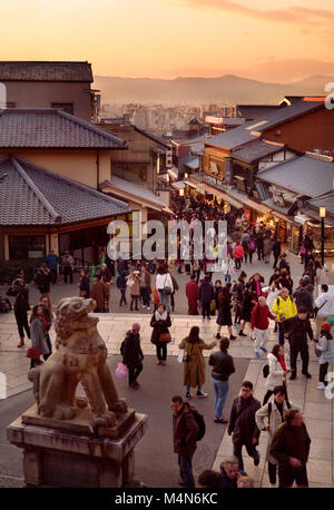 Matsubara dori street at sunset in autumn, busy with tourists and visitors at the entrance to Kiyomizu-dera Buddhist - Stock Photo