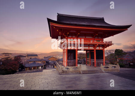 Nio-mon gate of Kiyomizu-dera Buddhist temple in a sunrise morning scenery. Two-storied Romon gate with Kyoto city - Stock Photo