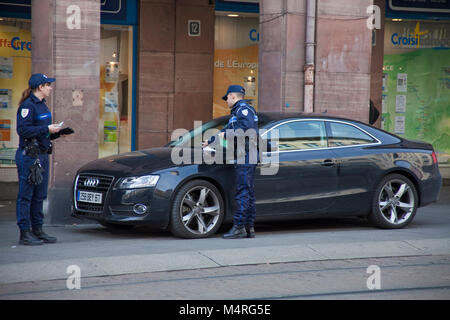 Police men writing a traffic ticket, city of Strasbourg, Alsace, Bas-Rhin, France, Europe - Stock Photo