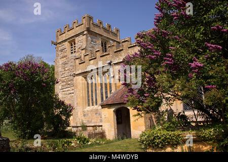Lilac bushes outside All Saints Church, Weston on Avon, a mainly 15th century grade 1 listed C of E church near - Stock Photo