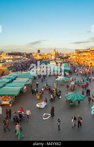 Crowded market on Jamaa El-Fna square at dusk, Marrakesh, Marrakesh-Safi, Morocco - Stock Photo