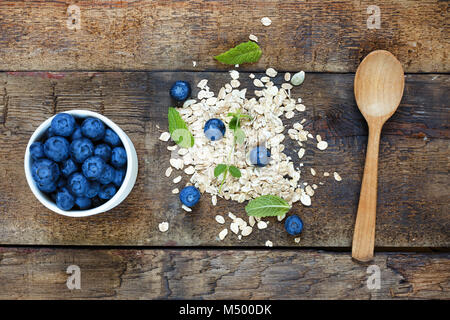 Concept: healthy food. blueberries and oat flakes - Stock Photo