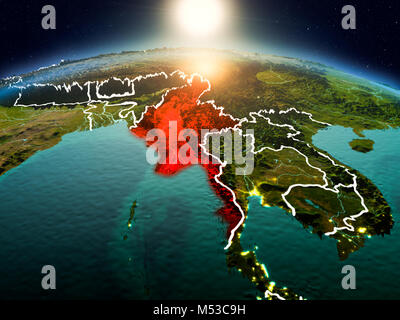 Sunrise above Myanmar highlighted in red on model of planet Earth in space with visible country borders. 3D illustration. - Stock Photo