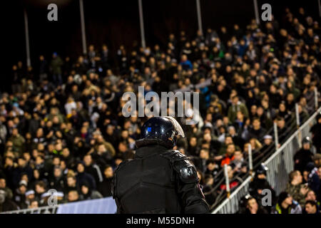The police at the stadium event secure a safe match against the hooligans - Stock Photo