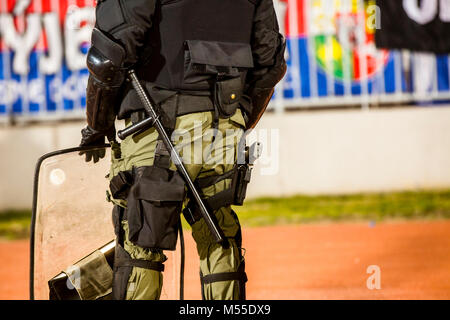 Special police unit at the stadium event secure a safe match against the hooligans - Stock Photo