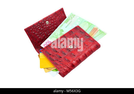 Red wallet with cash and credit cards - Stock Photo