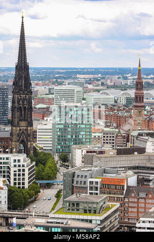 cityscape of Hamburg, Germany, with tower of former St. Nicholas' Church (L) and St. Catherine's Chruch (R) [recognizable - Stock Photo