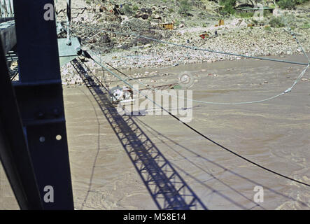 Trans canyon Pipeline (Historic)  Silver Bridge. Contractor's helicopter flying low over the Colorado River and - Stock Photo