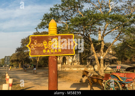 Bagan sign, horse and carriage in background in Bagan, Myanmar - Stock Photo