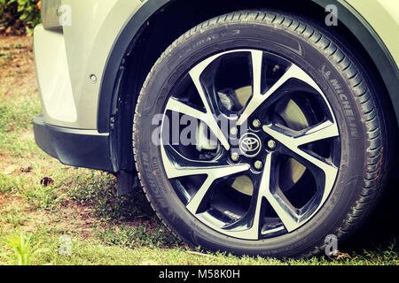 Concept shot of rims and tires of modern crossover car - Toyota CH-R - Stock Photo
