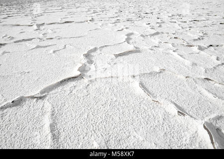 Salt crust in the shore of lagoon and salt lake Tuyajto, Altiplano (High Andean Plateau), Los Flamencos National - Stock Photo