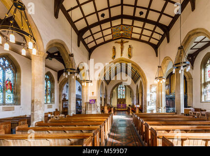 Interior of St Mary's parish church with traditional wooden pews and vaulted roof, Painswick, an unspoilt village - Stock Photo