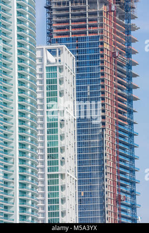 investment construction concrete canyon glass towers modern architecture - Stock Photo