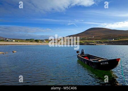 Curragh Moored at Dooega Village on the Atlantic Drive, Achill Island, County Mayo, Ireland - Stock Photo