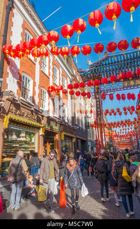 Colourful lanterns and a throng of people in Gerrard Street, Chinatown, to celebrate Chinese New Year. Westminster, - Stock Photo