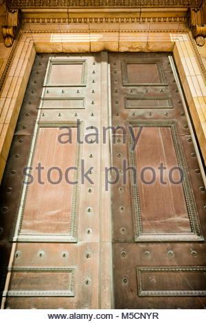 Large monumental bronze door entrance old ornate - Stock Photo
