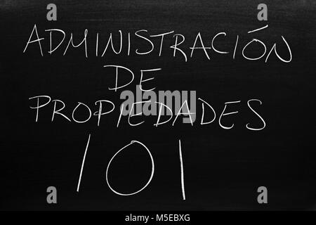The words Administración De Propiedades 101 on a blackboard in chalk - Stock Photo