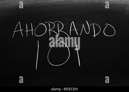 The words Ahorrando 101 on a blackboard in chalk - Stock Photo