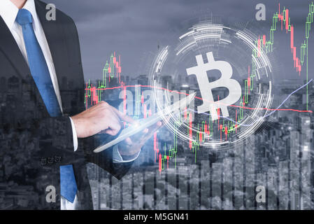 Businessman using the tablet deal bitcoin trading exchange stock market investment, forex with trend of graph, price - Stock Photo
