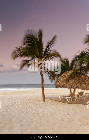 Carribean, Dominican Republic, Punta Cana, Playa Bavaro, beach at sunset - Stock Photo