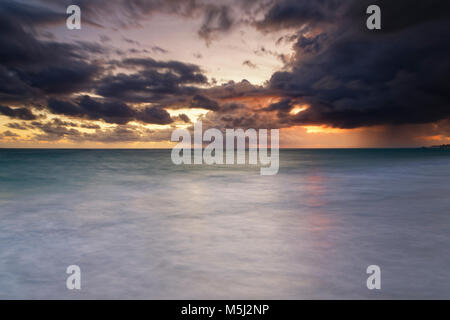 Carribean, Dominican Republic, Punta Cana, Playa Bavaro, view to the sea at sunrise - Stock Photo
