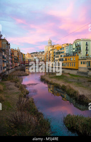 Spain, Catalunya, Girona, Cathedral and houses along the River Onyar in the evening - Stock Photo