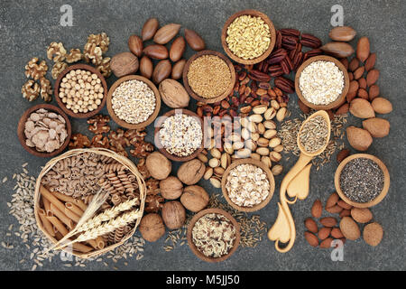 Food with high fiber content for a healthy diet with whole wheat bread, whole grain pasta, nuts, seeds, legumes, - Stock Photo