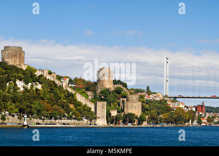 Rumelihisari Fortress and Bosphorus Bridge, in Istanbul, Turkey - Stock Photo