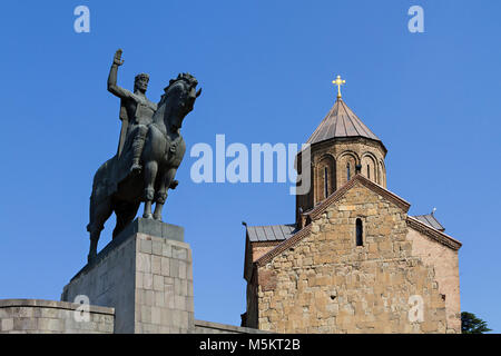 Statue of King Vakhtang Gorgasali and Metekhi Church in Tbilisi, Georgia. - Stock Photo
