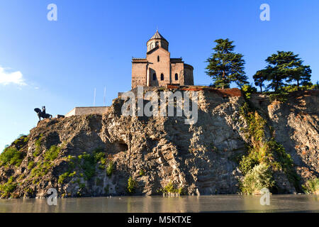 Metekhi Church and the statue of King Vahtang Gorgasali, in Tbilisi, Georgia. - Stock Photo