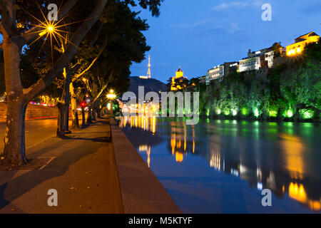 Night view over Tbilisi and River Kura at the twilight, in Tbilisi, Georgia - Stock Photo