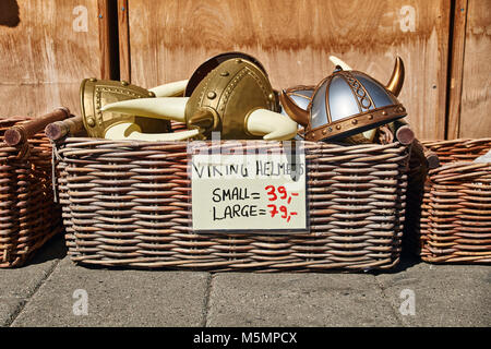 Oslo, Norway: May 1 2017 - Toy horned helmets in traditional Norwegian style in wicker basket are sold on the street - Stock Photo