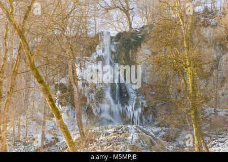 Uracher Wasserfall in winter - Stock Photo