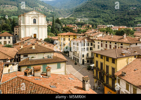 View over rooftops of Pisogne, a small town on the shore of Lake Iseo in the Brescia region of Northern Italy. - Stock Photo