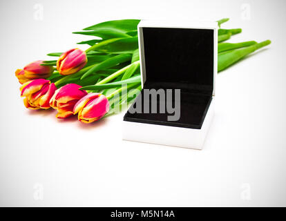 Open empty gift box, spring tulips. Women gift concept - Stock Photo