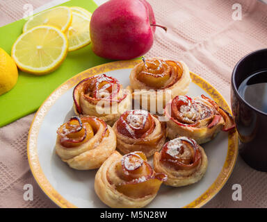 Homemade muffins with Apple, cinnamon, icing sugar on a plate. - Stock Photo