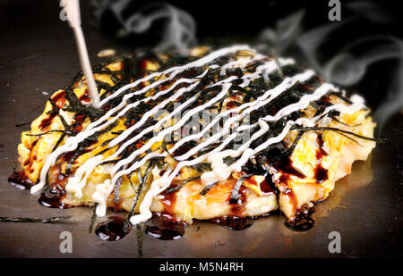Japanese Okonomiyaki is japanese pizza great and yammy - Stock Photo