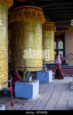 Thimphu, Bhutan.  Worshipers Turn Prayer Wheels at the National Memorial Chorten. - Stock Photo
