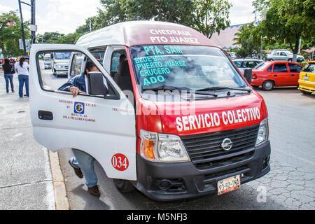 Cancun Mexico Yucatán Peninsula Quintana Roo Avenida Tulum Hispanic man bus van transportation colectivo share taxi - Stock Photo