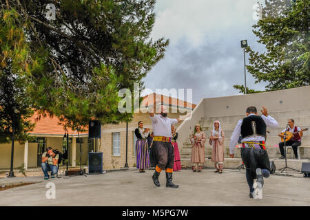 Arsos, Cyprus - October 8, 2017:  Cypriot dancers performing in traditional costumes. - Stock Photo