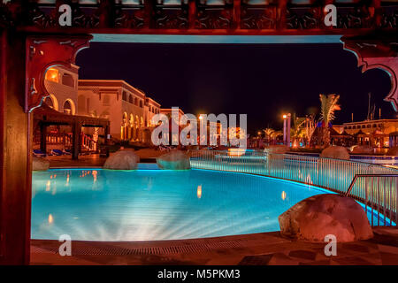 HURGHADA, EGYPT- FEBRUARY 22, 2010: Night view of pool in luxury resort in Egypt - Stock Photo