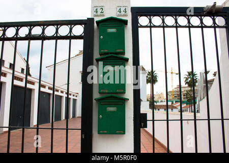 Mailboxes. Green Mailboxes. Estepona, Malaga, Spain. Picture taken – 24 february 2018. - Stock Photo
