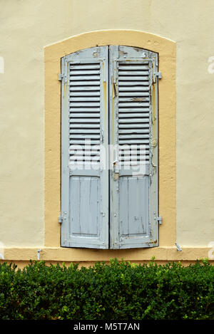 Shutters in front of the window - Stock Photo