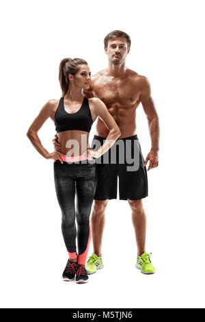Young sportsmen couple woman and man in studio on white background. A man looks at the camera - Stock Photo