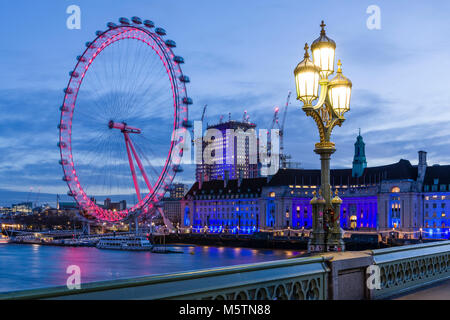 The London Eye and County Hall at dawn viewed from Westminster Bridge - Stock Photo