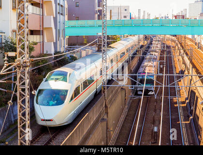 A unique scene of two trains passing at two different levels, high speed train on top track and subway on the lower. - Stock Photo